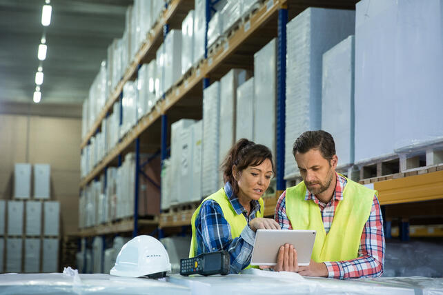 Image of a man and woman working in a warehouse
